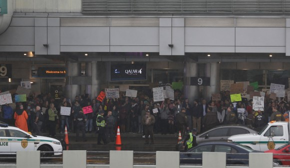 Protesters gather at the Miami International Airport against the executive order that President Donald Trump signed clamping down on refugee admissions and temporarily restricting travelers from seven predominantly Muslim countries in Miami, Florida on Jan. 29, 2017. Demonstrators gathered at airports across the country in protest of the order. (Joe Raedle/Getty Images)