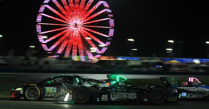Gustavo Yacaman in the #20 BAR1 Motorsports Oreca passes GTD cars entering Turn 3. (Chris Jasurek/Epoch Times)