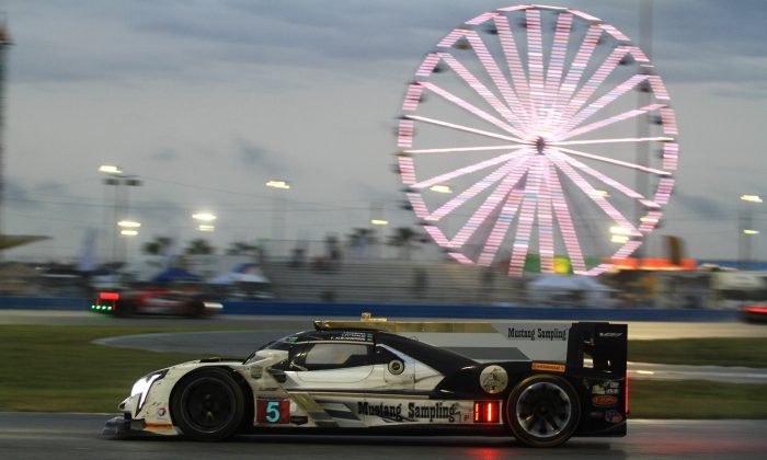 Felipe Albuquerque in the #5 Mustang Sampling Cadillac DPi led the field when the green flag waved Sunday morning. (Chris Jasurek/Epoch Times)