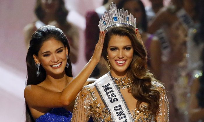 Iris Mittenaere of France is crowned the new Miss Universe 2016 by 2015 Miss Universe Pia Wurtzbach in coronation at the Mall of Asia in suburban Pasay city, south of Manila, Philippines on Jan. 30, 2017. (AP Photo/Bullit Marquez)