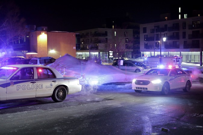 Police survey the scene after deadly shooting at a mosque in Quebec City, Canada, on Jan. 29, 2017. (Francis Vachon/The Canadian Press via AP)