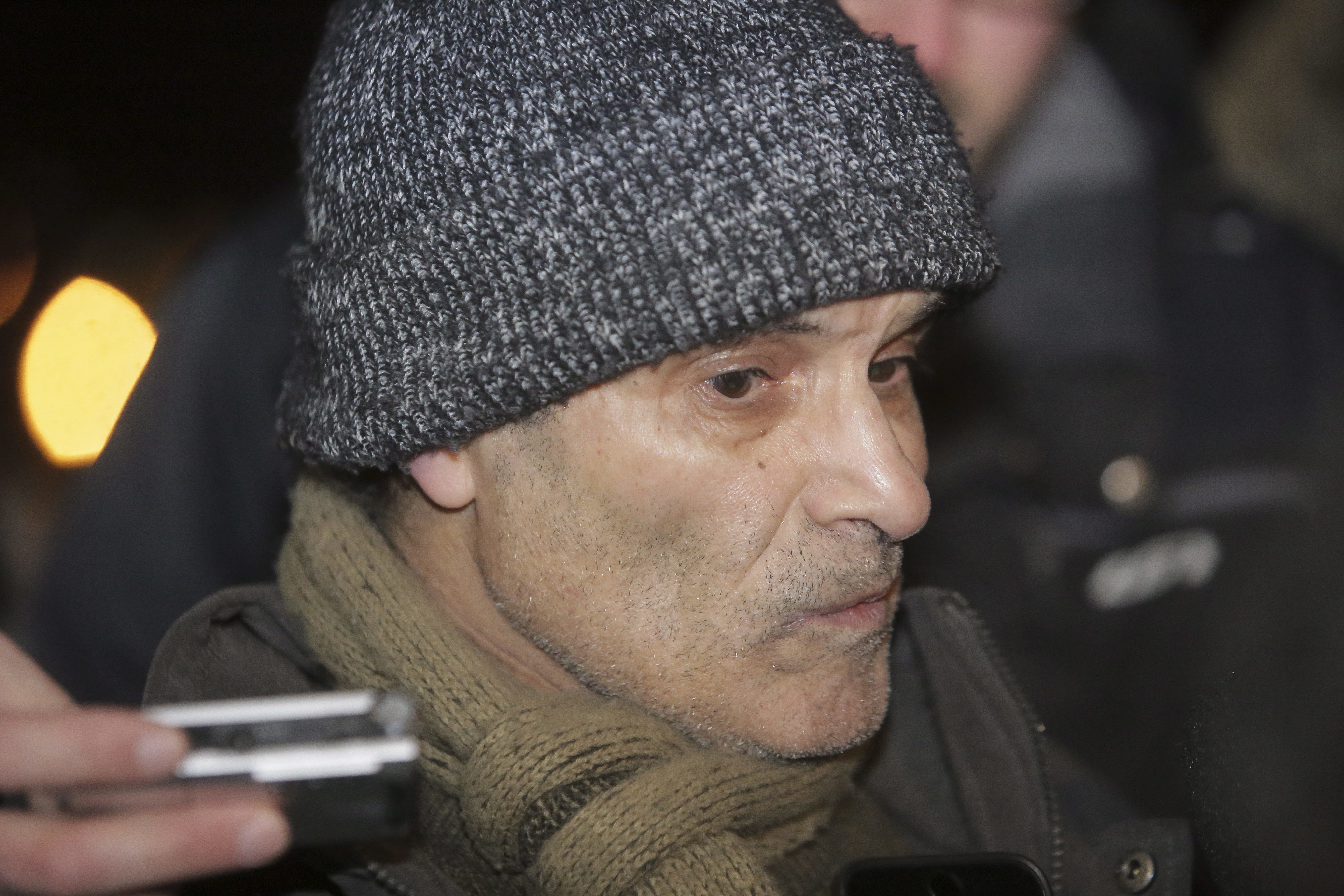 Mohamed Oudghiri speaks with the media near a Quebec City mosque after a deadly shooting on Jan. 29, 2017. (Francis Vachon/The Canadian Press via AP)