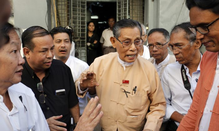 Tin Oo, center, senior leader of Myanmar's ruling National League for Democracy, talks to journalists as he leaves Ko Ni's house in Yangon, Myanmar Monday, Jan.30, 2017. A gunman killed Ko Ni on Sunday, shooting the lawyer in the head at close range as he walked out of the Yangon airport, the government said. (AP Photo/Thein Zaw)