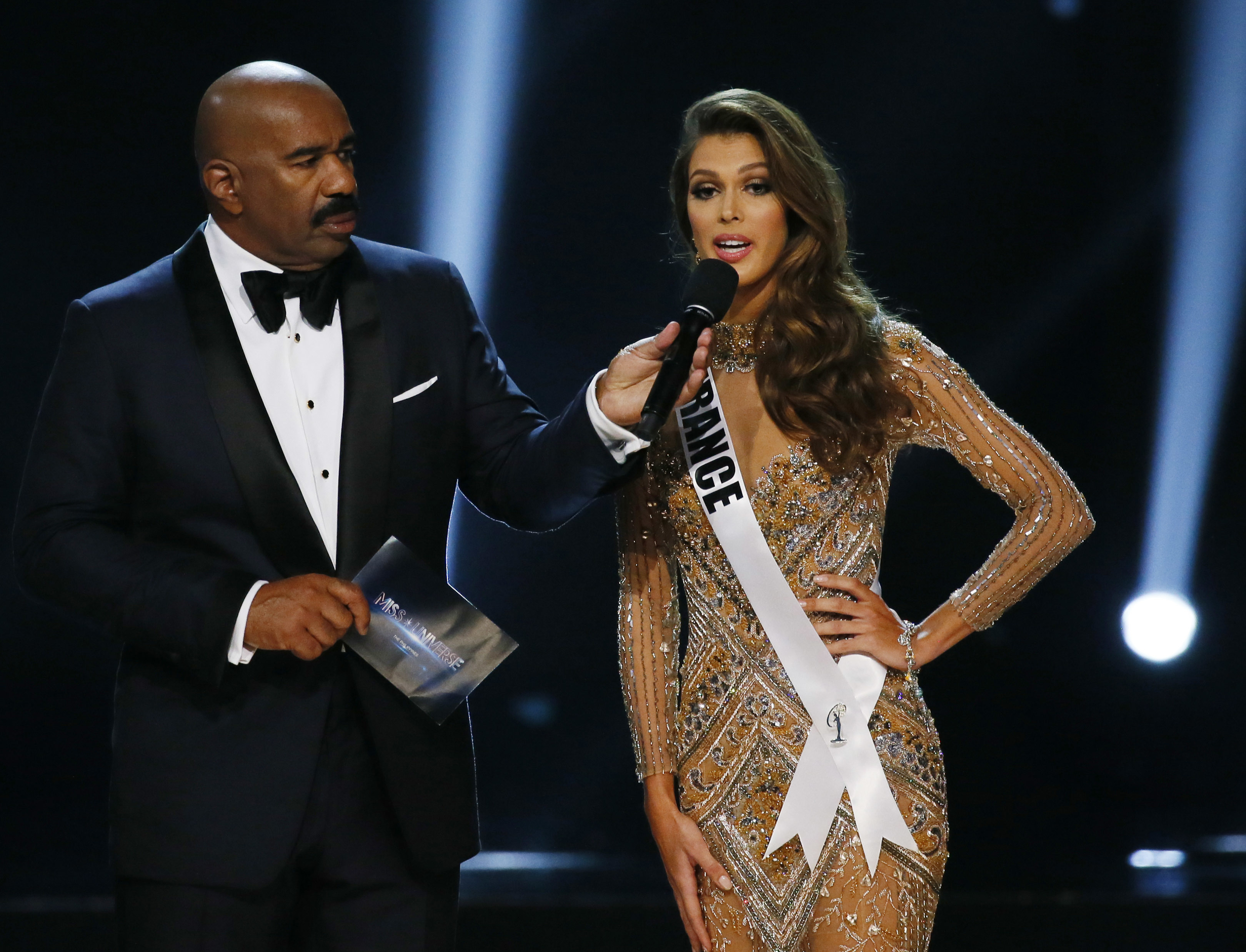Miss France Iris Mittenaere expounds on her answer during the question-and-answer portion of the Miss Universe 2016 competition  at the Mall of Asia in suburban Pasay city, south of Manila, Philippines on Jan. 30, 2017. (AP Photo/Bullit Marquez)