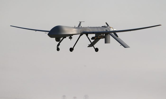 A U.S. Air Force MQ-1B Predator unmanned aerial vehicle (UAV), carrying a Hellfire missile in a file photo. (John Moore/Getty Images)