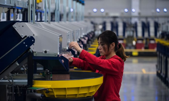 A worker checks the production in the packaging section of the newly opened Lego factory in Jiaxing, Zhejiang Province, China, on Nov. 24, 2016. (JOHANNES EISELE/AFP/Getty Images)