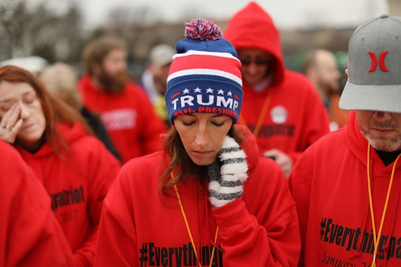 US President Donald Trump supporters pray on the National Mall during the inauguration of Donald Trump in Washington, DC, on Jan. 20, 2017. (Spencer Platt/Getty Images)