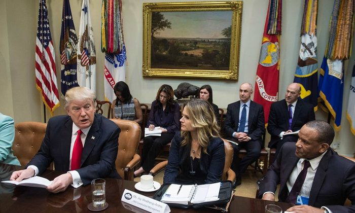 US President Donald Trump speaks as he meets with small business leaders in the Roosevelt Room at the White House in Washington on Jan. 30, 2017. (NICHOLAS KAMM/AFP/Getty Images)
