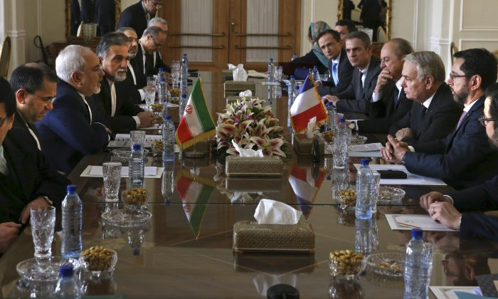 Iranian Foreign Minister Mohammad Javad Zarif, third left, his French counterpart Jean-Marc Ayrault, third right, and their delegations hold of talks in Tehran, Iran on Jan. 31, 2017. (AP Photo/Vahid Salemi)