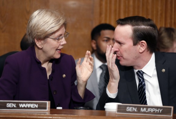 Senate Health, Education, Labor, and Pensions Committee members Sen. Elizabeth Warren, D-Mass. and Sen. Chris Murphy, D-Conn., talk on Capitol Hill in Washington on Jan. 31, 2017, prior to the start of the committee's executive session to discuss the nomination of Education Secretary-designate Betsy DeVos. (AP Photo/Alex Brandon)
