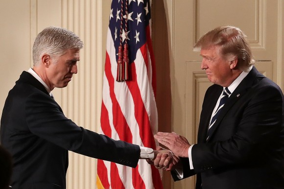 President Donald Trump (R) shakes hands with Judge Neil Gorsuch after nominating him to the Supreme Court during a ceremony in the East Room of the White House in Washington, DC Jan. 31, 2017. If confirmed, Gorsuch would fill the seat left vacant with the death of Associate Justice Antonin Scalia in Feb. 2016. (Chip Somodevilla/Getty Images)