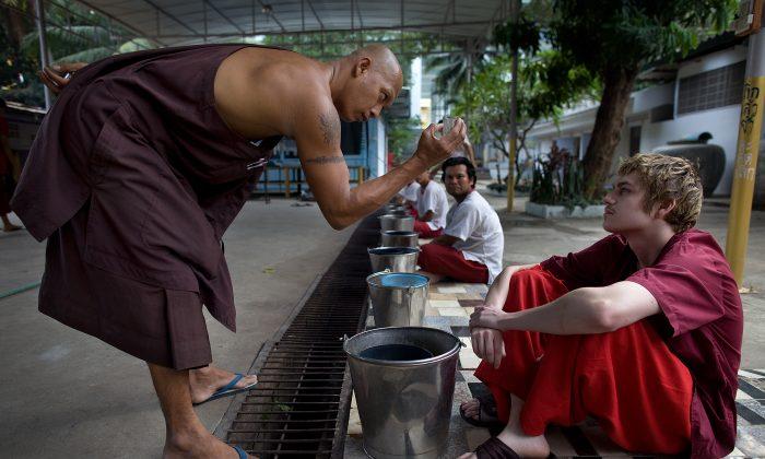 Sean Lampon,19, from Alaska gets advice at the Thamkrabok monastery in Saraburi, Thailand.  (Paula Bronstein /Getty Images)