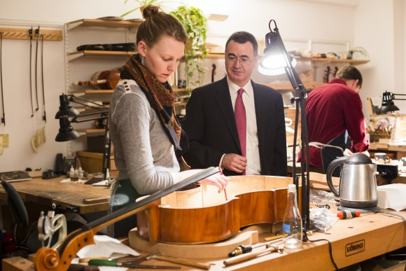 Elizabeth LaPorte and co-founder Bruno Price at the restoration shop of Rare Violins of New York in Manhattan, New York, on Jan. 9, 2017. (Samira Bouaou/Epoch Times)