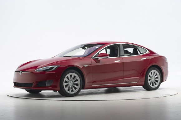 This Sept. 7, 2016, photo provided by the Insurance Institute for Highway Safety shows a Tesla Model S before crash safety testing. The car earned good ratings in four of the institute's five tests, but fell short of getting the highest safety rating in the newest crash tests administered by the insurance industry. (Matt Daly/Insurance Institute for Highway Safety via AP)