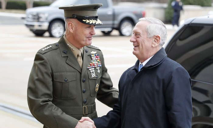 Joint Chiefs Chairman Gen. Joseph Dunford greets Defense Secretary Jim Mattis at the Pentagon on Jan. 21, 2107. By visiting Japan and South Korea on his first official overseas trip, Mattis is seeking to reinforce key alliances after President Donald Trump's campaign-trail complaints that defense treaties disadvantaged the United States. (AP Photo/Alex Brandon, File)