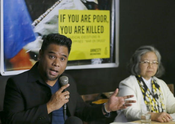 """Amnesty International campaigner Wilnor Papa, left, gestures during a video news conference with their London counterpart Rachel Chhoa-Howard and Sis. Maria Vida Cordero, right, in suburban Quezon city, northeast of Manila, Philippines. Wednesday, Feb. 1, 2017. A majority of the thousands of killings of poor suspects under Philippine President Rodrigo Duterte's anti-drug crackdown appear to be """"extrajudicial executions,"""" Amnesty International said Wednesday, and may constitute crimes against humanity. (AP Photo/Bullit Marquez)"""