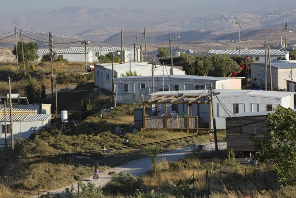 In this file photo, buildings in Amona, an unauthorized Israeli outpost in the West Bank, east of the Palestinian town of Ramallah. (AP Photo/Oded Balilty)