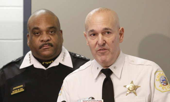 Jonathan Lewin, Deputy Chief Technology and Records Group with the Chicago Police Department accompanied by Police Superintendent Eddie Johnson at a news conference in Chicago on Feb. 1, 2017. (AP Photo/Teresa Crawford)