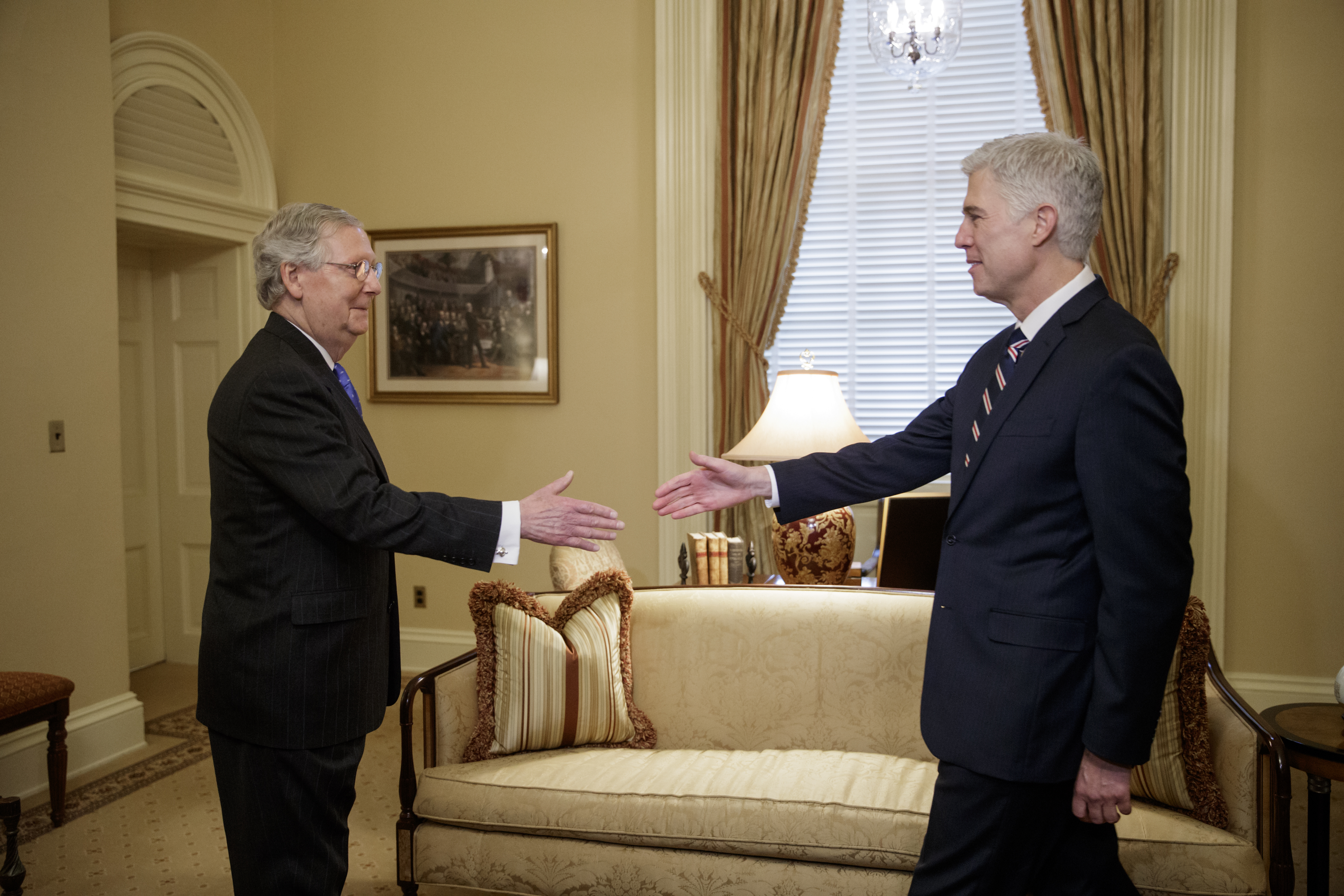 Supreme Court Justice nominee Neil Gorsuch is greeted by Senate Majority Leader Mitch McConnell of Ky. on Capitol Hill in Washington on Feb. 1, 2017. (AP Photo/J. Scott Applewhite)