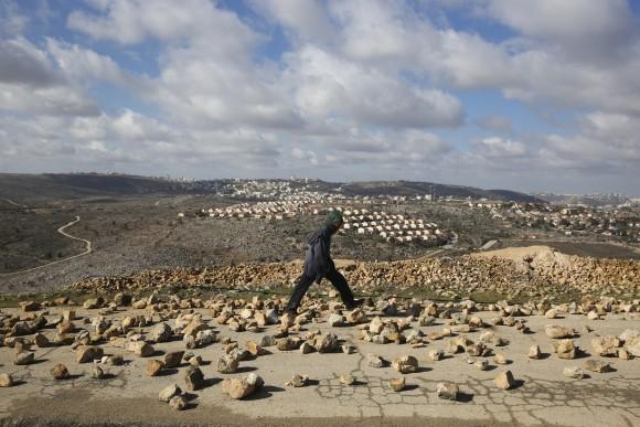 A settler walks outside Amona outpost, on Feb. 1, 2017. (AP Photo/Oded Balilty)