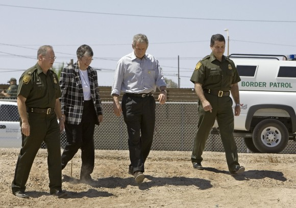 Former President George W. Bush (2R) tours the US-Mexico border with US Border Patrol Yuma Sector Chief Ronald Colburn (L), Arizona Gov. Janet Napolitano (2L) and US Border Patrol Chief David Aguilar (R) at San Luis, Arizona on May 18 2006 . (PAUL J. RICHARDS/AFP/Getty Images)