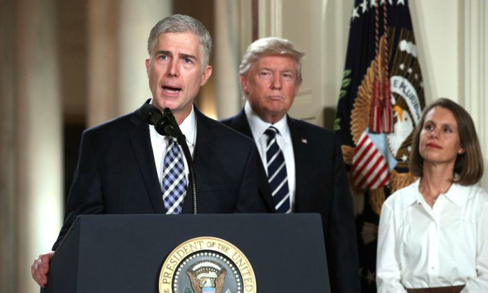 Judge Neil Gorsuch delivers brief remarks after being nominated by U.S. President Donald Trump to the Supreme Court with his wife Marie Louise Gorshuch during a ceremony in the East Room of the White House in Washington, DC. on Jan. 31, 2017. (Alex Wong/Getty Images)