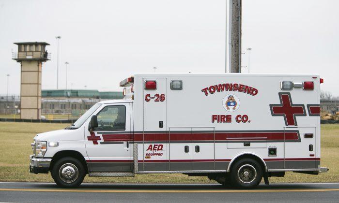 An ambulances drives into the Vaughn Correctional Center near Smyrna, Del., on Feb. 1, 2017. (Suchat Pederson/The Wilmington News-Journal via AP)