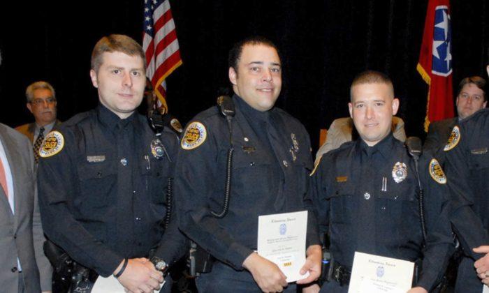 Metro Police Department shows Officer Eric Mumaw (C) receiving the department's Lifesaving Award. (Metro Nashville Police Department via AP)