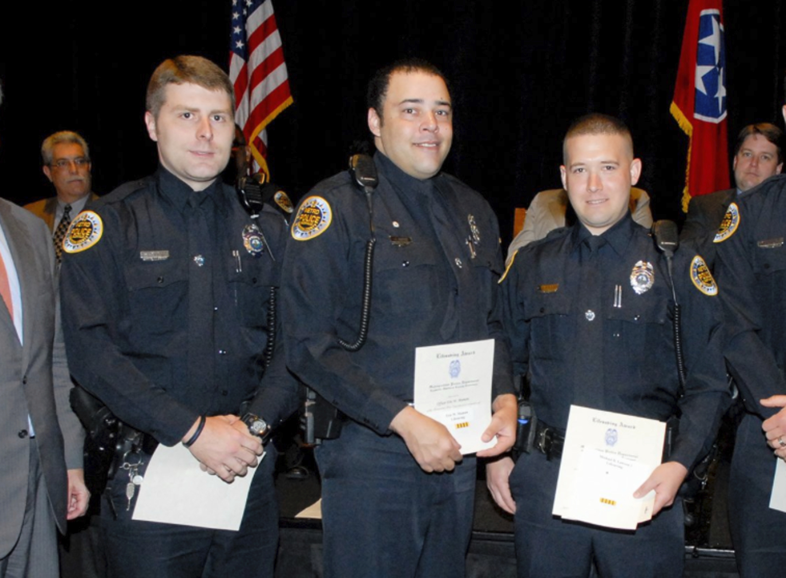 Metro Police Department shows Officer Eric Mumaw (C) receiving the department's Lifesaving Award. (Metro Nashville Police Department via AP)