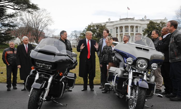 President Donald Trump and Vice President Mike Pence meet with Harley Davidson executives and Union Representatives on the South Lawn of the White House in Washington on Feb. 2, 2017. (AP Photo/Pablo Martinez Monsivais)