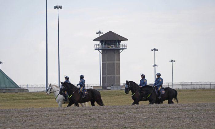 Mounted police patrol travel along Smyrna Landing Road alongside James T. Vaugh Corrections center in Smyrna, Del., on Feb. 2, 2017. (Suchat Pederson/The Wilmington News-Journal via AP)
