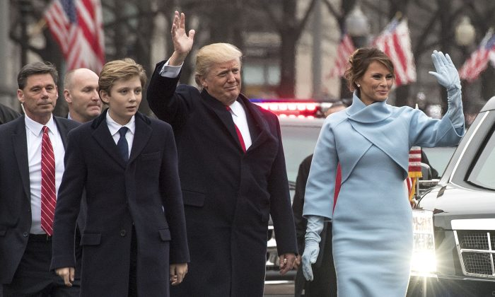 President Donald Trump and first lady Melania Trump, along with their son Barron, walk in their inaugural parade in Washington on Jan. 20, 2017. (Kevin Dietsch - Pool/Getty Images)