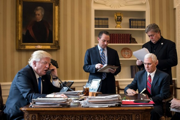 President Donald Trump speaks on the phone with Russian President Vladimir Putin in the Oval Office of the White House in Washington on, Jan. 28, 2017. Also pictured, from left, White House Chief of Staff Reince Priebus, Vice President Mike Pence, and White House Chief Strategist Steve Bannon. (Drew Angerer/Getty Images)
