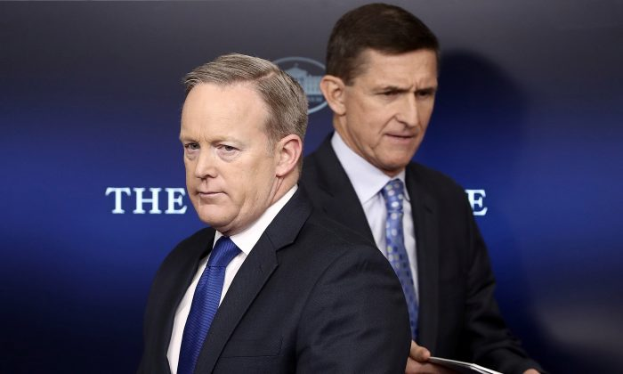 "White House Press Secretary Sean Spicer (L) yields the briefing room podium to National Security Adviser Michael Flynn in Washington on Feb. 1, 2017. Flynn said the White House is ""officially putting Iran on notice"" for a recent missile test and support for Houthi rebels in Yemen. (McNamee/Getty Images)"