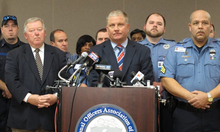 Geoffrey Klopp, center, president of the Correctional Officers Association of Delaware, speaks about a prison uprising in Dover, on Feb. 2, 2017. (AP Photo/Brian Witte)