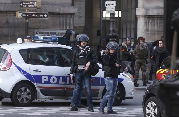 Police officers guard the access to the Louvre museum in Paris,Friday, Feb. 3, 2017. Paris police say a soldier has opened fire outside the Louvre Museum after he was attacked by someone, and the area is being evacuated. (AP Photo/Thibault Camus)
