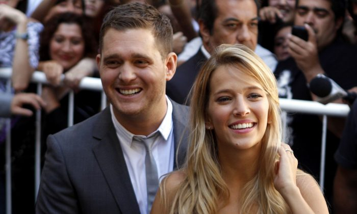 Canadian pop star Michael Buble (L) Argentine actress Luisana Lopilato in Buenos Aires, Argentina on March 31, 2011. (AP Photo/Natacha Pisarenko, File)