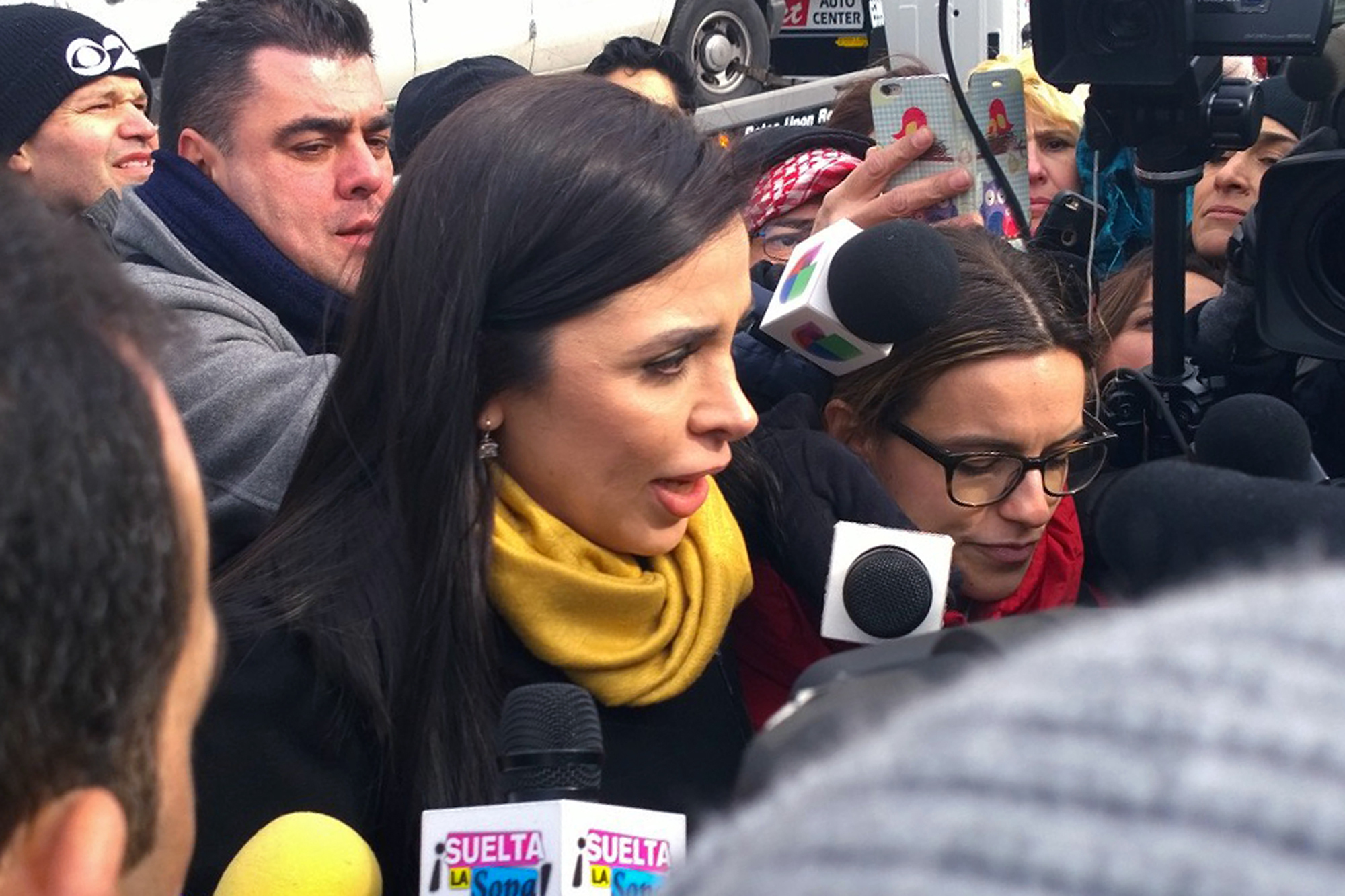 """Emma Coronel Aispuro, wife of Joaquin """"El Chapo"""" Guzman, talks with reporters as she leaves Brooklyn federal court following her husband's court appearance, in New York on Feb. 3, 2017. (AP Photo/Elizabeth Williams)"""