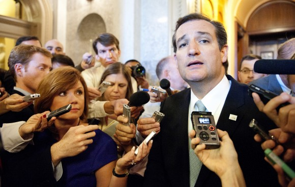 Senator Ted Cruz, R-Tex., speaks to reporters after ending his talk-a-thon on the floor of the US Senate in Washington on Sept. 25, 2013. Cruz ended his overnight protest against Obamacare after a 21-hour speech. (JIM WATSON/AFP/Getty Images)