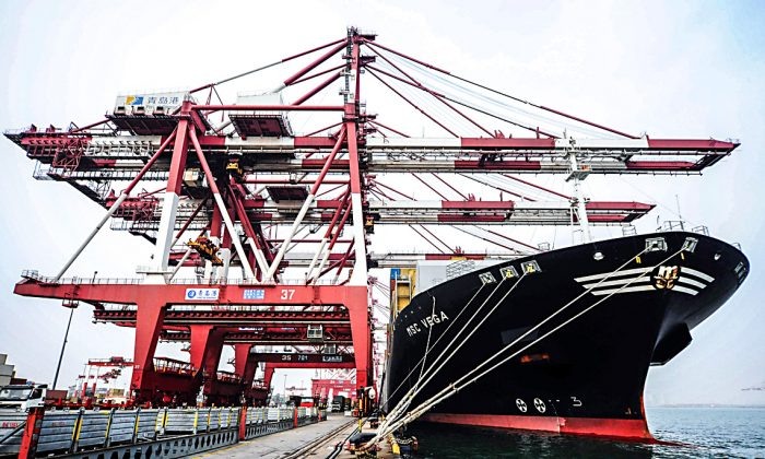 A cargo ship at a port in Qingdao, China, on March 8, 2016. (STR/AFP/Getty Images)