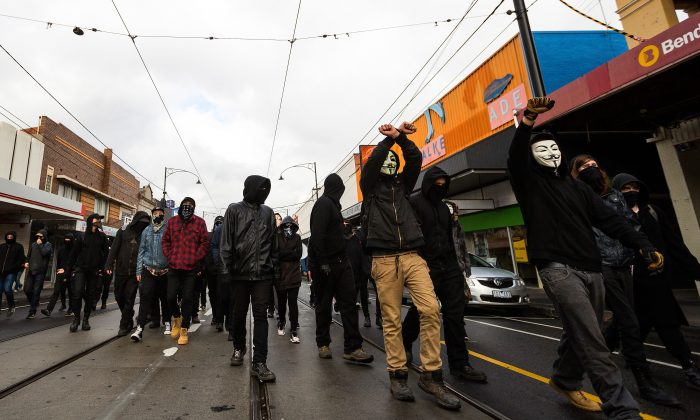 Members of ANTIFA march up Sydney Road in Coburg on May 28, 2016 in Melbourne, Australia.   (Chris Hopkins/Getty Images)