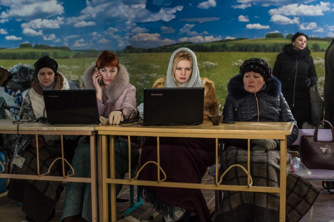 Volunteers register local residents for humanitarian assistance inside a school in Avdiivka, Ukraine, on Feb. 3, 2017. The conflict with Russia-backed rebels has intensified dramatically since the weekend, leaving the front-line town without water or electricity. (Brendan Hoffman/Getty Images)