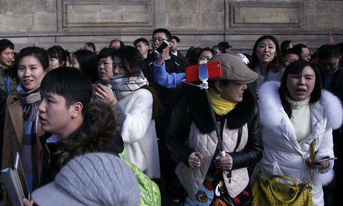 Tourist leave the Louvre museum in Paris, on Friday, Feb. 3, 2017. (AP Photo/Thibault Camus)