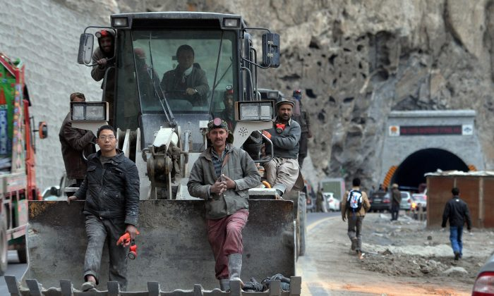 A file image of Pakistani and Chinese workers sitting on an excavator as they leave a newly built tunnel in northern Pakistan's Gojal Valley, on Sept. 25, 2015. The project is part of China's Belt and Road Initiative. (Aamir Qureshi/AFP/Getty Images)