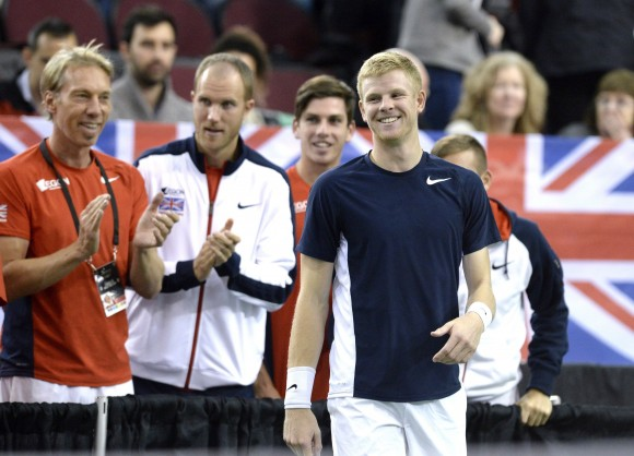 Great Britain's Kyle Edmund smiles as his team advances to the quarterfinals after the match was declared forfeited by umpire Arnaud Gabas of France on Feb. 5, 2017 in Ottawa. (The Canadian Press/Justin Tang)