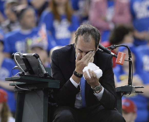 Umpire Arnaud Gabas of France holds his face after being hit by a ball from Canada's Denis Shapovalov in a match against Great Britain's Kyle Edmund on Feb. 5, 2017 in Ottawa. (The Canadian Press/Justin Tang)