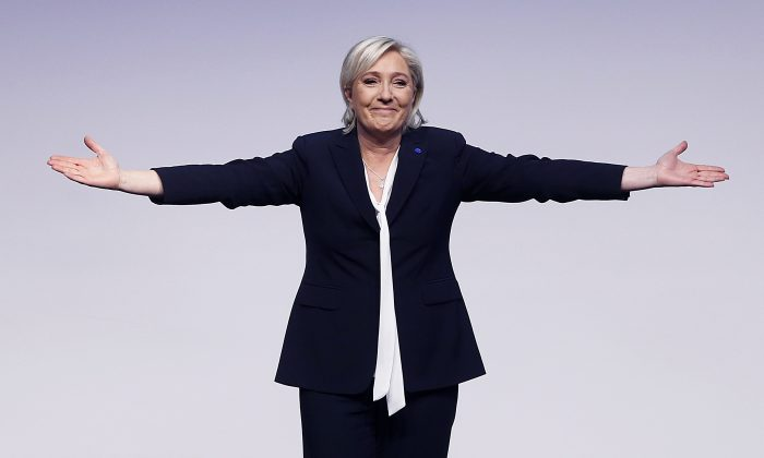 Conservative leader and candidate for next spring presidential elections Marine le Pen from France celebrates after her speech at a meeting of European Nationalists in Koblenz, Germany, in this file photo. (AP Photo/Michael Probst)