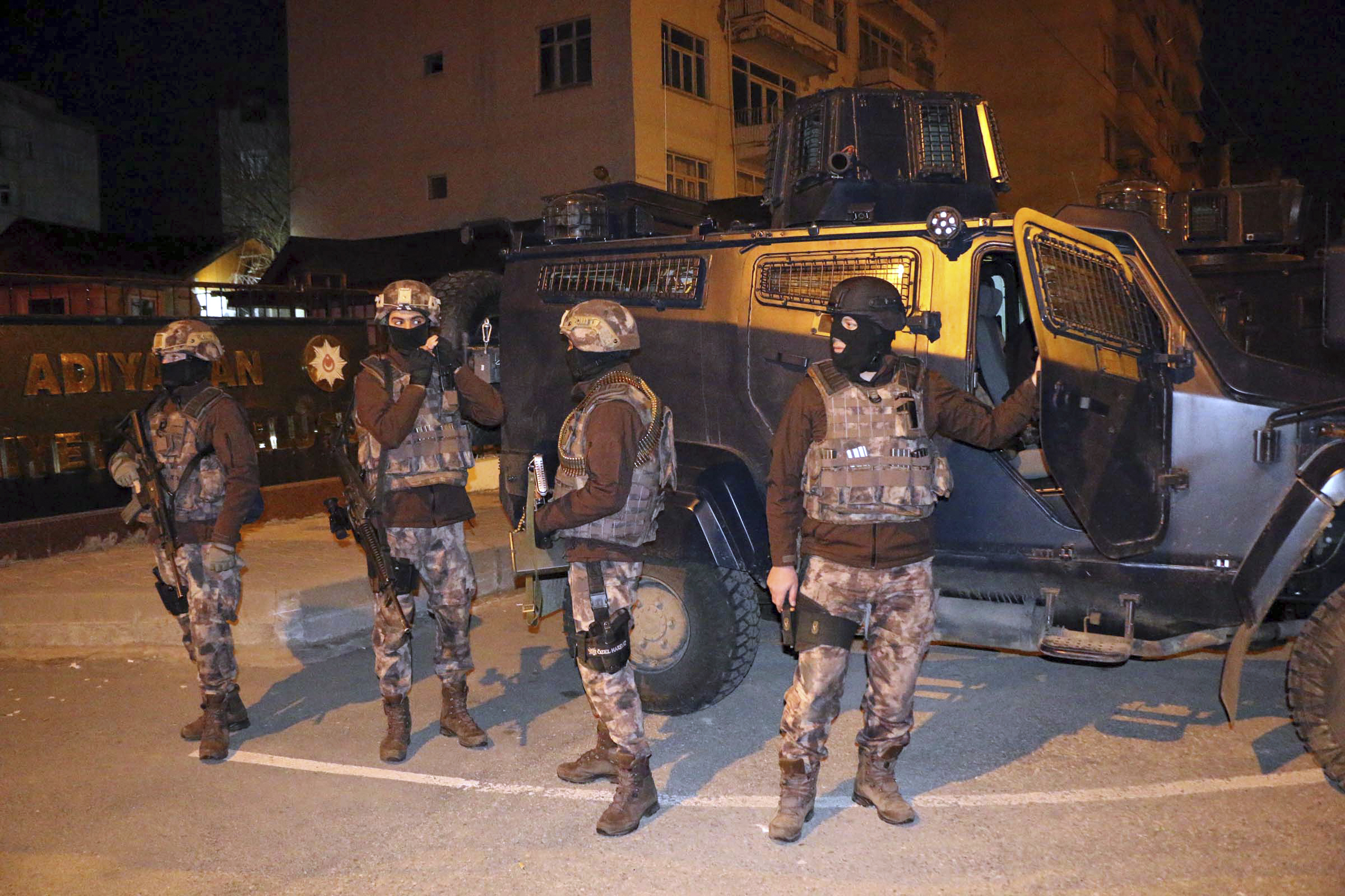 Turkish anti-terrorism police stand by their armoured vehicle during an operation to arrest people over alleged links to ISIS, in Adiyaman, southeastern Turkey on Feb. 5, 2017.  (Mahir Alan/Dha-Depo Photos via AP)
