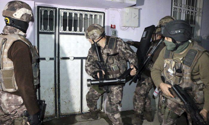 Turkish anti-terrorism police break a door during an operation to arrest people over alleged links to ISIS, in Adiyaman, southeastern Turkey on Feb. 5, 2017. (Mahir Alan/Dha-Depo Photos via AP)