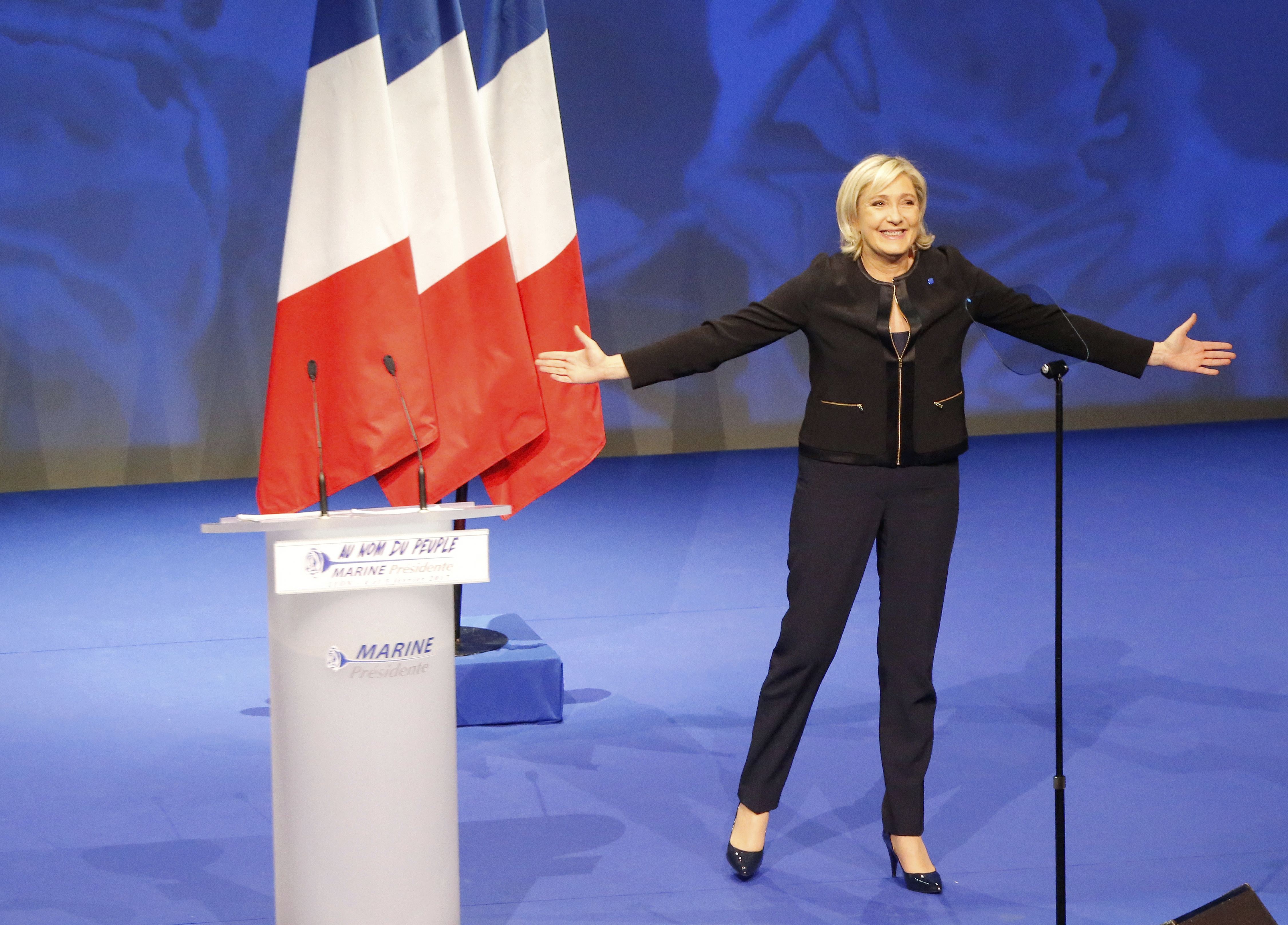 Conservative leader presidential candidate Marine Le Pen acknowledges applauses as she arrives as to a conference in Lyon, France on Feb. 5, 2017. (AP Photo/Michel Euler)